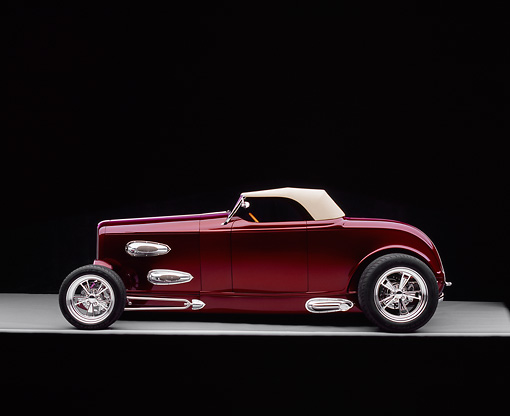 AUT 26 RK0395 02 © Kimball Stock 1932 Ford Custom Roadster Burgundy Profile On Gray Floor Studio