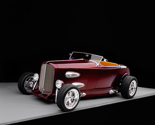 AUT 26 RK0400 07 © Kimball Stock 1932 Ford Custom Roadster Burgundy 3/4 Side View On Gray Floor Studio