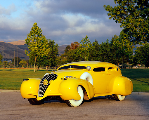 AUT 26 RK0427 02 © Kimball Stock 2000 Gangster Custom Car Yellow 3/4 Front View On Pavement By Grass And Trees