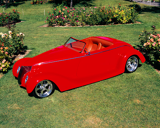 AUT 26 RK0451 03 © Kimball Stock 1936 Ford Roadster Red Overhead 3/4 Front View On Grass By Flowers