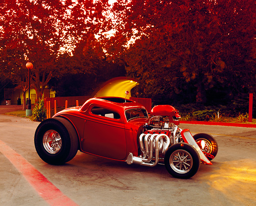 AUT 26 RK0462 01 © Kimball Stock 1933 Ford 3-Window Coupe Candy Orange 3/4 Front View On Pavement By Trees At Dusk