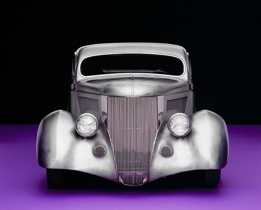 AUT 26 RK0506 01 © Kimball Stock 1936 Ford Cole Foster 3 Window Coupe Raw Silver Head On Shot On Purple Floor Studio