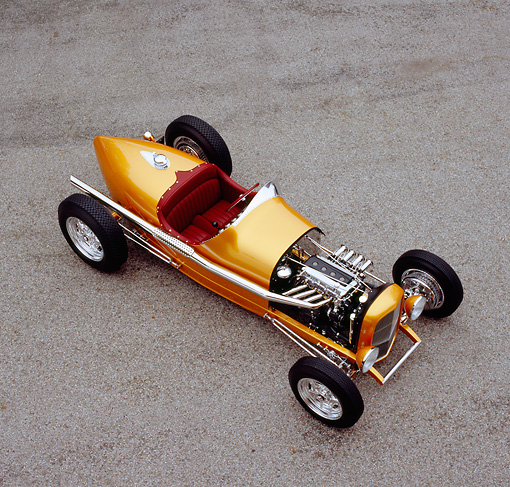 AUT 26 RK0530 04 © Kimball Stock 2005 Zane Speedster Orange Overhead 3/4 Front View On Pavement