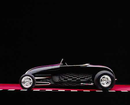 AUT 26 RK0537 09 © Kimball Stock 1929 Ford Track Nose Roadster Black And Cream Profile On Red Floor Checkered Line Studio