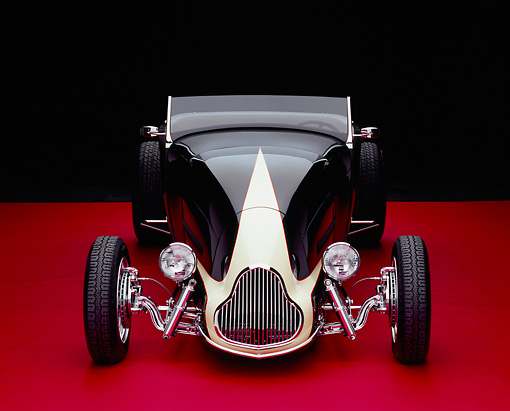 AUT 26 RK0538 24 © Kimball Stock 1929 Ford Track Nose Roadster Black And Cream Head On Shot Red Floor Studio