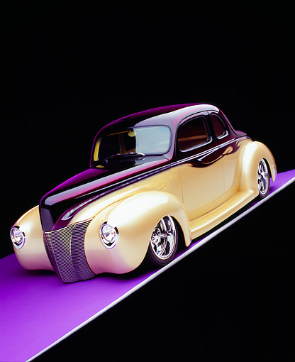 AUT 26 RK0547 07 © Kimball Stock 1940 Ford Deluxe Opera Coupe Purple And Champagne Slanted 3/4 Front View On Purple Floor Studio