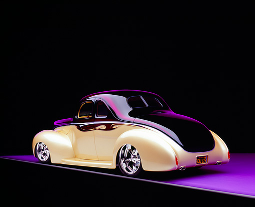 AUT 26 RK0551 04 © Kimball Stock 1940 Ford Deluxe Opera Coupe Purple And Champagne 3/4 Rear View On Purple Floor Studio