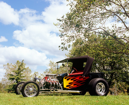 AUT 26 RK0559 01 © Kimball Stock 1923 Ford Roadster Pick-Up Truck Black With Flames 3/4 Front View On Grass