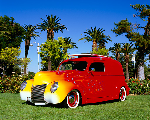 AUT 26 RK0578 05 © Kimball Stock 1940 Mercury Delivery Sedan Red With Flames 3/4 Front View On Grass By Palm Trees