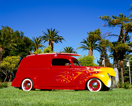 AUT 26 RK0579 01 © Kimball Stock 1940 Mercury Delivery Sedan Red With Flames 3/4 Side View On Grass By Palm Trees
