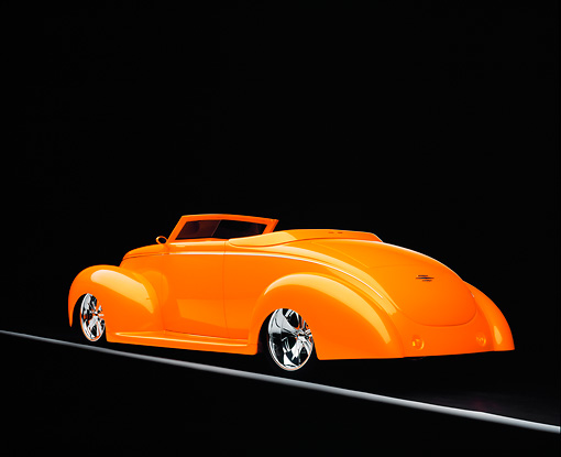 AUT 26 RK0594 01 © Kimball Stock 1939 Ford, Deluxe, Convertible, Orange 3/4 Rear View On Gray Line Studio