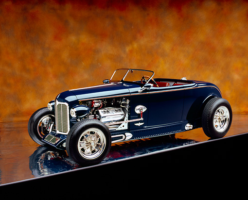 AUT 26 RK0596 08 © Kimball Stock 1932 Speedway Special Roadster Blue 3/4 Side View On Mylar Floor Brown Mottled Background Studio