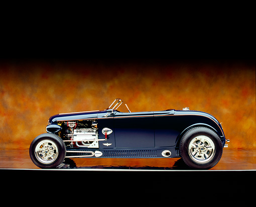 AUT 26 RK0597 09 © Kimball Stock 1932 Speedway Special Roadster Blue Profile Shot On Mylar Floor Brown Mottled Background Studio
