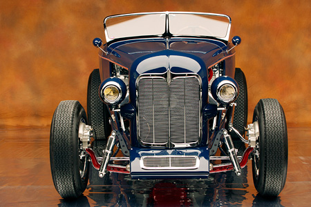 AUT 26 RK0638 01 © Kimball Stock 1932 Speedway Special Roadster Blue Low Head On Shot On Mylar Floor Studio
