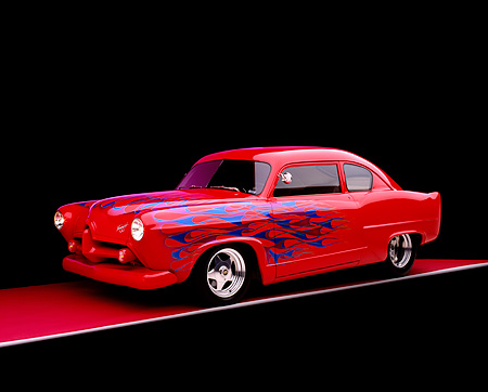 AUT 26 RK0657 07 © Kimball Stock 1952 Kaiser Frazer Henry J Coupe Red With Flames 3/4 Side View On Red Floor Gray Line Studio