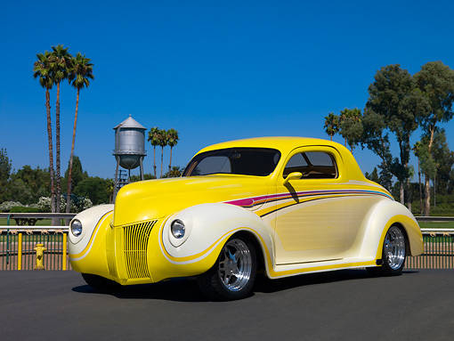 AUT 26 RK0684 01 © Kimball Stock 1940 Ford 3 Window Coupe Art Himsil Yellow 3/4 Front View On Pavement