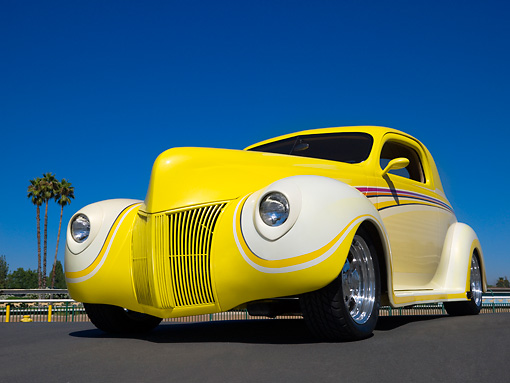 AUT 26 RK0685 01 © Kimball Stock 1940 Ford 3 Window Coupe Art Himsil Yellow 3/4 Low Front View On Pavement