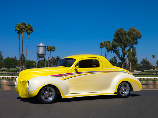 AUT 26 RK0686 01 © Kimball Stock 1940 Ford 3 Window Coupe Art Himsil Yellow 3/4 Front View On Pavement