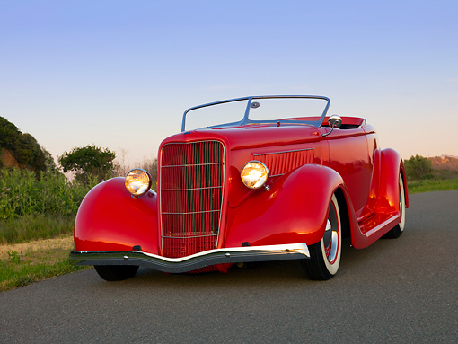 AUT 26 RK1140 01 © Kimball Stock 1935 Ford Roadster Red Low 3/4 Front View On Pavement