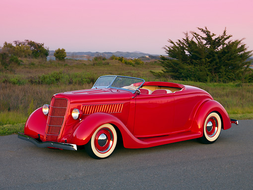 AUT 26 RK1141 01 © Kimball Stock 1935 Ford Roadster Red Low 3/4 Side View On Pavement