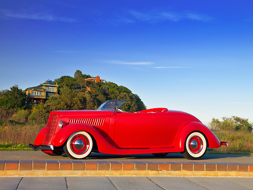 AUT 26 RK1143 01 © Kimball Stock 1935 Ford Roadster Red Low 3/4 Side View On Pavement