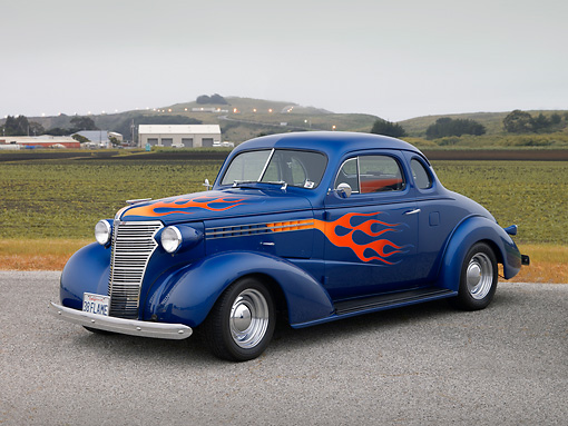 AUT 26 RK1152 01 © Kimball Stock 1938 Chevrolet Master Deluxe Coupe Blue 3/4 Side View On Pavement