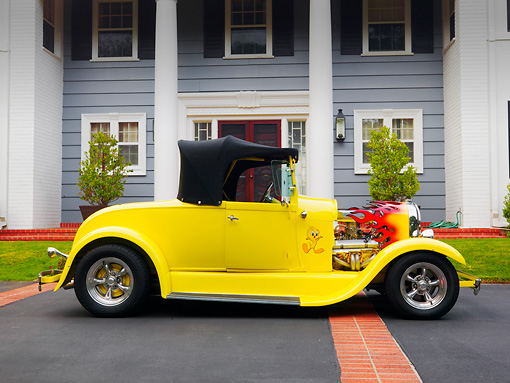 AUT 26 RK1212 01 © Kimball Stock 1929 Ford Hot Rod Yellow Convertible Profile View On Pavement By House