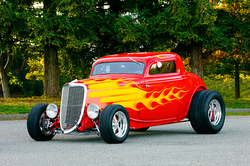 AUT 26 RK1226 01 © Kimball Stock 1934 Ford 3-Window Coupe With Flames 3/4 Front View On Pavement By Trees