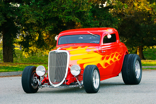 AUT 26 RK1227 01 © Kimball Stock 1934 Ford 3-Window Coupe With Flames 3/4 Front View On Pavement By Trees