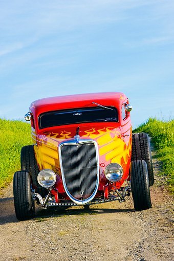 AUT 26 RK1228 01 © Kimball Stock 1934 Ford 3-Window Coupe With Flames Head On View On Dirt By Grass Hill