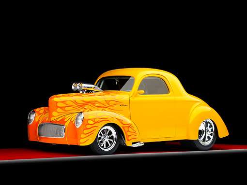 AUT 26 RK1231 01 © Kimball Stock 1941 Willys Coupe Yellow With Flames 3/4 Front View Studio