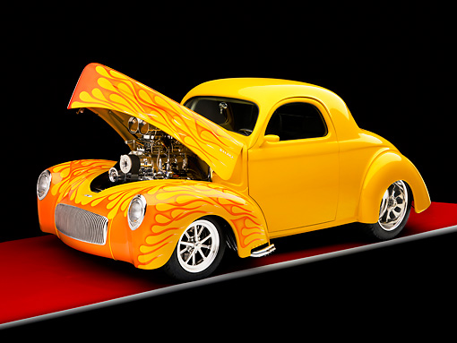 AUT 26 RK1233 01 © Kimball Stock 1941 Willys Coupe Yellow With Flames 3/4 Front View Studio