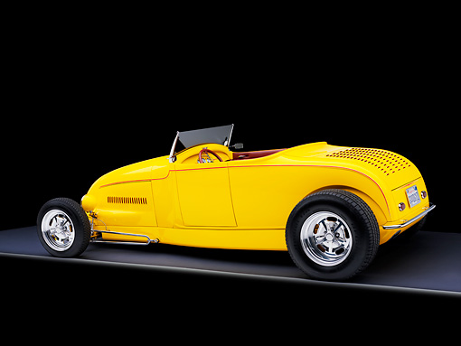 AUT 26 RK1294 01 © Kimball Stock Goodguys' 1929 Ford Roadster Hot Rod Yellow 3/4 Rear View Studio