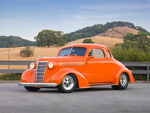 AUT 26 RK1307 01 © Kimball Stock 1938 Chevrolet Coupe Hot Rod Orange 3/4 Front View By Hills And Trees