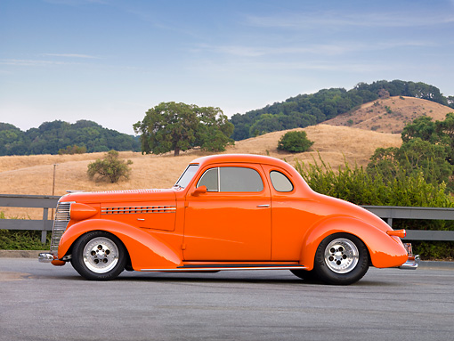 AUT 26 RK1309 01 © Kimball Stock 1938 Chevrolet Coupe Hot Rod Orange 3/4 Front View By Hills And Trees
