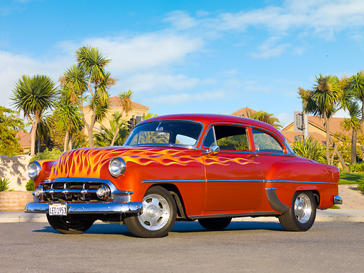 AUT 26 RK2669 01 © Kimball Stock 1953 Chevrolet 210 Coupe Hot Rod Orange With Flames 3/4 Front View On Pavement By Palm Trees