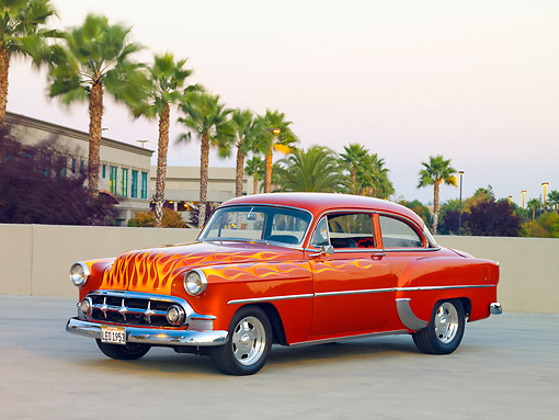 AUT 26 RK2670 01 © Kimball Stock 1953 Chevrolet 210 Coupe Hot Rod Orange With Flames 3/4 Front View On Pavement By Palm Trees