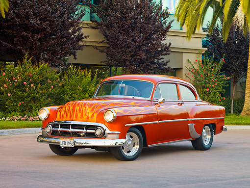 AUT 26 RK2671 01 © Kimball Stock 1953 Chevrolet 210 Coupe Hot Rod Orange With Flames 3/4 Front View On Pavement By Shrubs And Trees