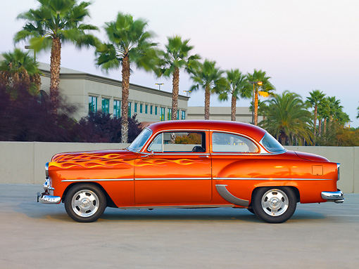 AUT 26 RK2674 01 © Kimball Stock 1953 Chevrolet 210 Coupe Hot Rod Orange With Flames Profile View On Pavement By Palm Trees