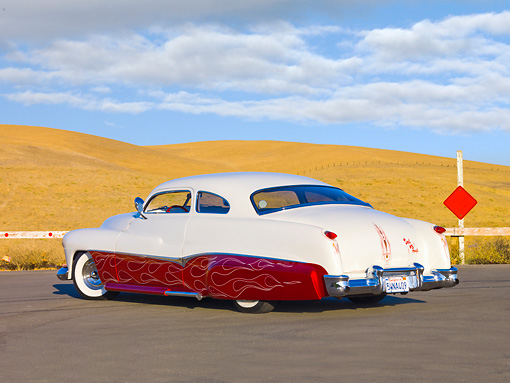 AUT 26 RK2680 01 © Kimball Stock 1951 Mercury Coupe Custom Hot Rod Red And White 3/4 Rear View On Pavement By Hills