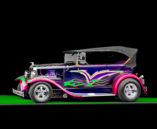 AUT 26 RK2699 01 © Kimball Stock 1931 Ford Model A Deluxe Phaeton Hot Rod Purple Green And Pink Flames Profile View Studio