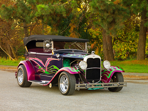 AUT 26 RK2701 01 © Kimball Stock 1931 Ford Model A Deluxe Phaeton Hot Rod Purple Green And Pink Flames 3/4 Front View On Pavement By Trees