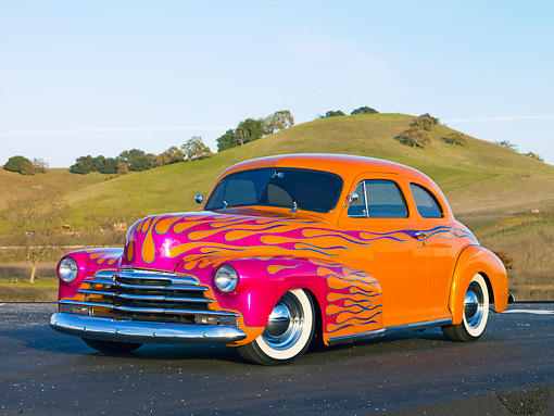 AUT 26 RK2716 01 © Kimball Stock 1948 Chevrolet Coupe Hot Rod Orange And Pink 3/4 Front View On Pavement By Hills