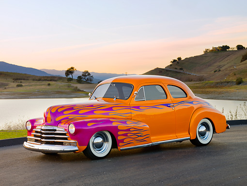 AUT 26 RK2724 01 © Kimball Stock 1948 Chevrolet Coupe Hot Rod Orange And Pink 3/4 Front View On Pavement By Hills And Lake