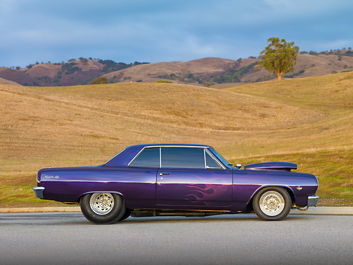 AUT 26 RK2740 01 © Kimball Stock 1965 Chevrolet Chevelle SS Hot Rod Purple Profile View On Pavement By Hills