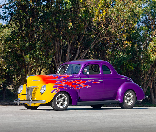 AUT 26 RK2751 01 © Kimball Stock 1940 Ford Coupe Hot Rod Purple With Flames 3/4 Front View On Pavement By Trees