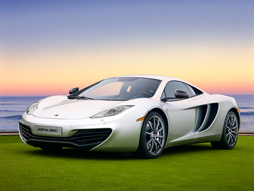 AUT 28 RK0126 01 © Kimball Stock 2012 McLaren MP4-12C Prototype Silver 3/4 Front View On Grass By Building