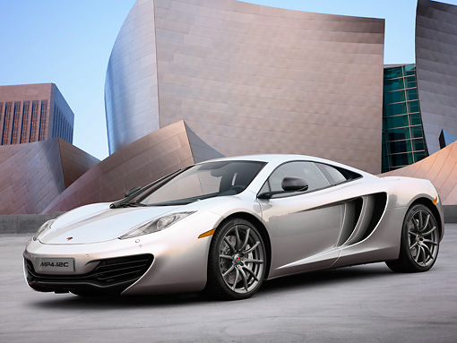 AUT 28 RK0131 01 © Kimball Stock 2012 McLaren MP4-12C Prototype Silver 3/4 Front View On Grass By Building
