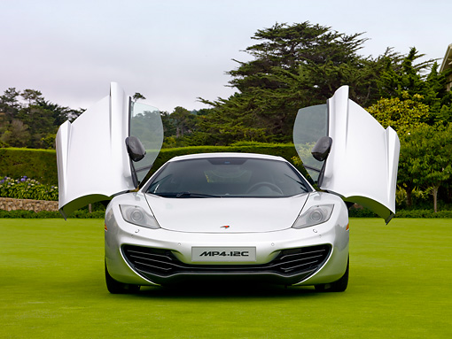 AUT 28 RK0156 01 © Kimball Stock 2012 McLaren MP4-12C Prototype Silver Head On View On Grass