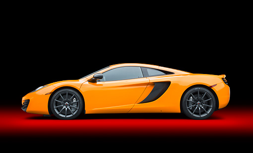AUT 28 RK0172 01 © Kimball Stock 2012 McLaren MP4-12C Orange Profile View In Studio
